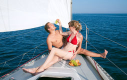 Man and woman on a yacht Royalty Free Stock Photo