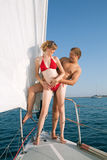Man and woman on a yacht stock image