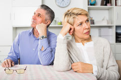 Man and woman 50-54 years old are offended at each other. Man and women 50-54 years old are offended at each other because of the misunderstanding in his home Stock Photo