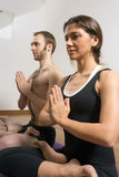 Man and Woman in a Yoga Pose - Vertical Royalty Free Stock Images