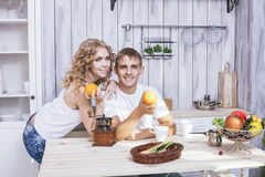 Man and woman young and beautiful couple in the kitchen home coo Stock Photo