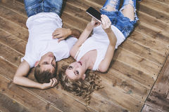Man and woman young and beautiful couple in white shirts taking Stock Photo