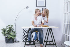 Man and woman young and beautiful pair at home in the office at Stock Image