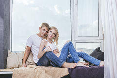 Man and woman young and beautiful pair at home in warmth and com Stock Photography