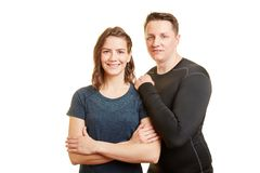 Man and woman young couple. As fitness trainers smiling together in teamwork Royalty Free Stock Images