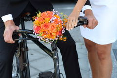 Man and woman. Young couple with wedding flowers bouquet and vintage bike Royalty Free Stock Photo