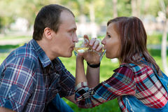 Man and woman. Young men and girl on picnic in garden Stock Image