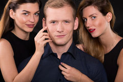 Man is a womanizer Royalty Free Stock Image