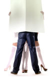 Man and womans holding empty white board Royalty Free Stock Images