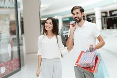 Man and woman in shopping mall. Couple is laughing, happy. royalty free stock photo