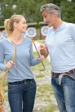 Man and woman at archery centre. Man and women at archery centre archery Royalty Free Stock Images