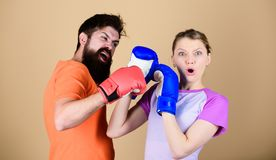 Man and woman in boxing gloves. Boxing sport concept. Couple girl and hipster practicing boxing. Sport for everyone. Man and women in boxing gloves. Boxing sport royalty free stock images