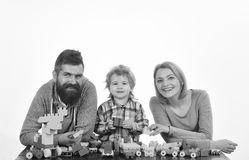Man, woman and boy play on white background. Kindergarten and family concept. Mom, dad and kid in playroom. Man, women and boy play on white background royalty free stock photography