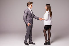 Man and woman business handshake isolated on gray background. Businessman and business woman handshake. stock photos
