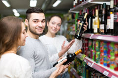 Man and women choosing wine Stock Photo