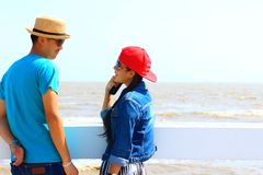 Man woman couple smilling and relax happiness in summer on beach. Man women couple smilling and relax happiness on beach Stock Photography