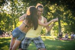 Man and woman dancing dip move training Latin American dance. Man and women dancing dip move training Latin American dance outdoors Stock Photography