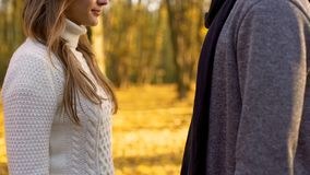 Man and woman dating in autumn forest, falling in love, romantic atmosphere stock photography