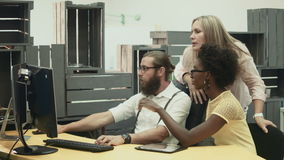 Man and women discussing project on computer