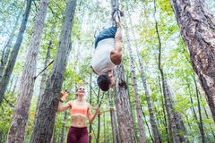 Man and woman doing functional fitness in outdoor gym stock images