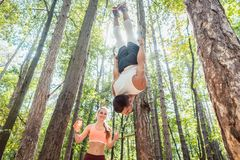 Man and woman doing functional fitness in outdoor gym royalty free stock photography
