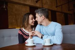 Couple in love on a date in cafe in Valentines day Stock Images