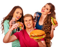 Man and women eating big sandwich with cola.  Isolated. Royalty Free Stock Photo
