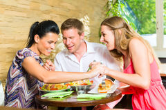 Man and women eating fresh salad for breakfast Stock Images