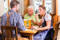 Man and woman eating in bavarian restaurant Royalty Free Stock Photos