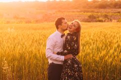 Man and woman embracing in poppy field on the dusk. Man and women embracing in poppy field on the dusk, countryside Malta stock photography