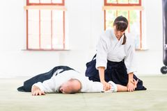 Man and woman fighting at Aikido martial arts school royalty free stock images