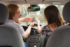 Couple arguing in car. Man and women funny couple arguing in car having relationship problem, yelling at each other royalty free stock photos