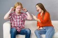 Man and woman having fight. Man and women having conflict. Female ignoring what her boyfriend is saying. Friendship, couple breakup difficulties and problems royalty free stock image