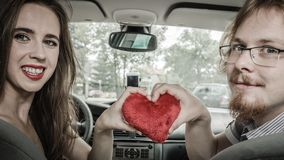 Man and woman showing love in car stock images