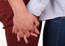 Holding hands. Man and women are holding hands Royalty Free Stock Images