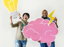 Man and woman holding light bulb and pink cloud icons. Man and women holding light bulb and pink cloud icons Stock Photography