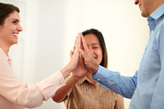 Man and women huddle their hands Royalty Free Stock Photography