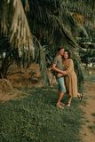 Man and woman hugging under palm trees Stock Photography