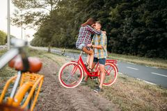 Man and woman kissing on retro bike Royalty Free Stock Photography