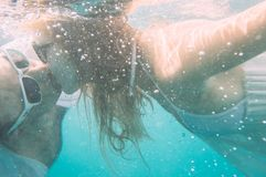 Man and woman kissing under the water In the sea royalty free stock photo