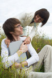 The man and women with laptop Stock Images