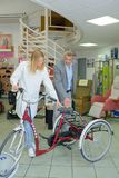 Man and woman looking at tricycle. Man and women looking at tricycle tricycle stock photography