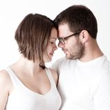 Man and woman in love touching. Man and women in love touching on white Stock Image