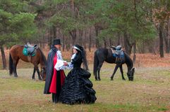 Man, woman and horses. Royalty Free Stock Photos