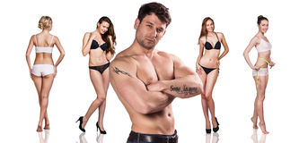 Man and women with perfect bodies. On the white background Royalty Free Stock Photography