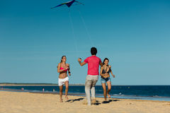 Man and women playing boule on beach Royalty Free Stock Photo
