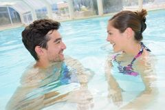 Man and woman in pool royalty free stock image