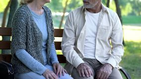 Man and woman in 70s dating in park, tenderness and love relations, togetherness. Man and women in 70s dating in park, tenderness and love relations royalty free stock photo