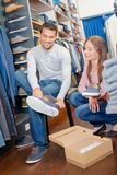 Man and woman in shoe shop Stock Photography