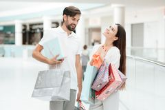Man and woman are walking to another store in shopping mall. Couple is happy. royalty free stock photo